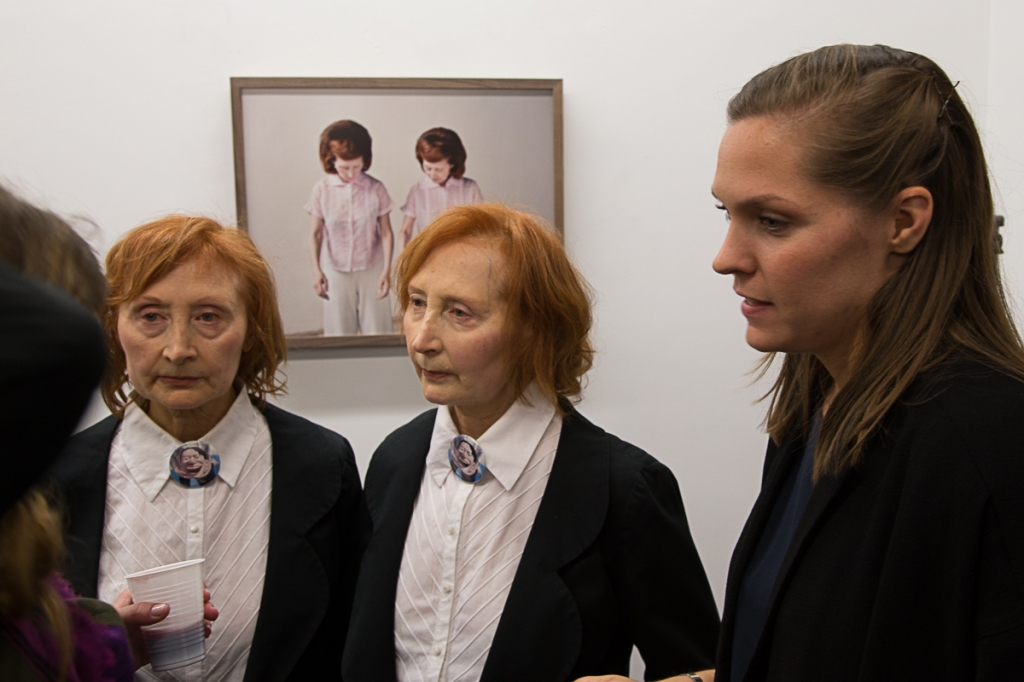 Photographer Maja Daniels with twin sisters Mady and Monette during the exhibition opening at the Galerie Polka, Paris. © Rémi Gruber