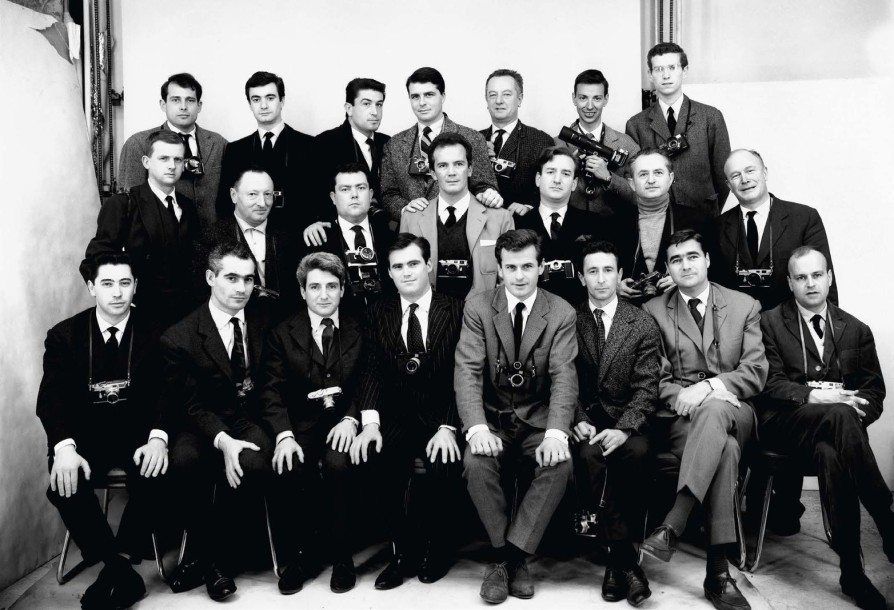 Family portrait: Paris Match photographers pose with their Leica's. © Paris Match Archive. 1st row, from left to right: Lucien Nau, Jacques de Potier, Gérard Géry, Patrice Habans, René Vital, Jack Garofalo, Daniel Camus and Philippe Le Tellier. 2nd row: Michel Descamps, Maurice Jarnoux, André Lefebvre, Walter Carone, Willy Rizzo, Izis and Hubert de Segonzac. 3rd row: Georges Ménager, Claude Azoulay, Charles Courrière, François Gragnon, Pierre Vals, Roger Picherie and Jean-Claude Sauer. March 1960.
